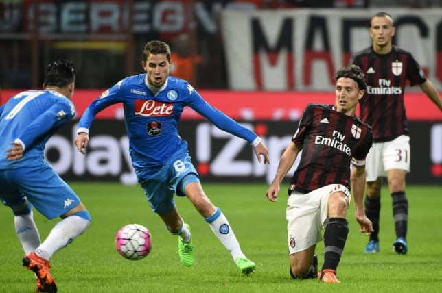 AC Milan's midfielder Riccardo Montolivo (R) vies for the ball with Napoli's Brazilian midfielder Jorginho (C) during the Italian Serie A football match between AC Milan and Napoli at San Siro Stadium in Milan on October 4, 2015. AFP PHOTO / OLIVIER MORINOLIVIER MORIN/AFP/Getty Images