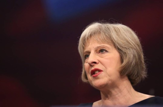 """MANCHESTER, ENGLAND - OCTOBER 06: Home Secretary Theresa May delivers her keynote speech to delegates during the Conservative Party Conference on October 6, 2015 in Manchester, England. Home Secretary Theresa May addressed delegates on day three of the Conservative Party conference at Manchester Central and warned that it is """"impossible to build a cohesive society"""" and the UK needs to have an immigration limit. (Photo by Christopher Furlong/Getty Images)"""