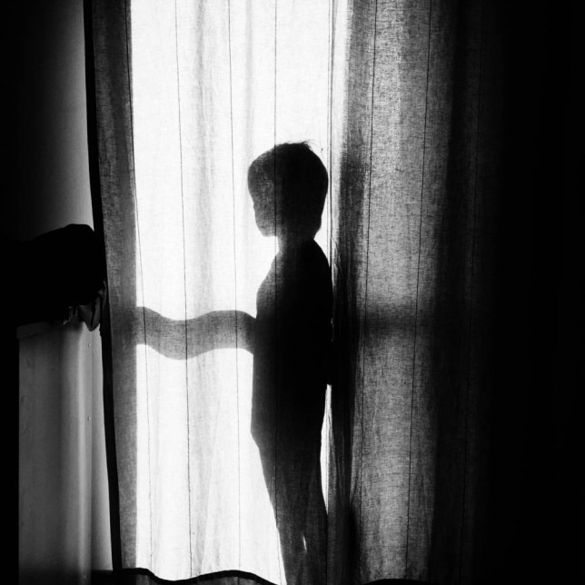 Silhouette Boy Standing Behind Curtain At Home