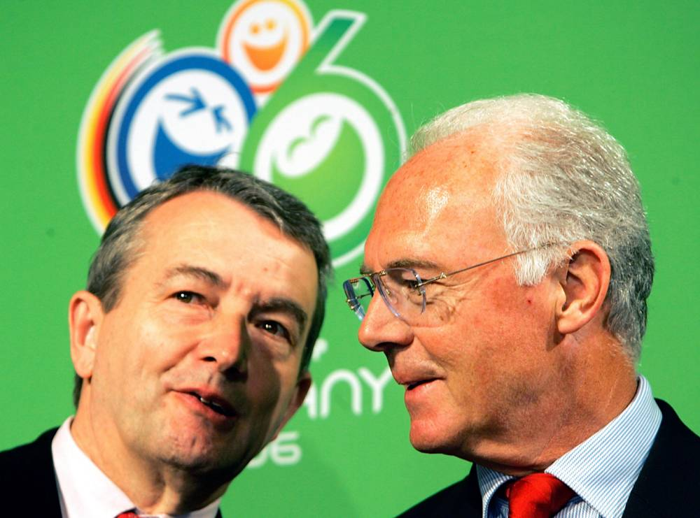 FILE - In this March 6, 2006 file photo German soccer legend and head of the organizing committee for the 2006 soccer World Cup in Germany, Franz Beckenbauer, right, talks to Wolfgang Niersbach during a workshop in the build up for the World Cup in D¸sseldorf, western Germany. (AP Photo/Frank Augstein, file)