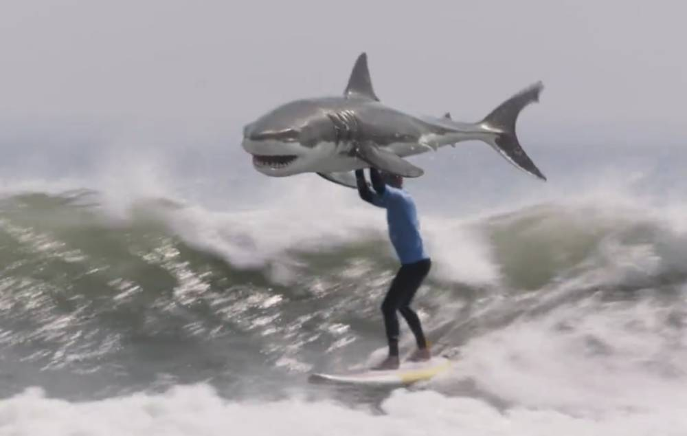 Pro-surfer Mick Fanning is not impressed with KFC's new ad parodying his shark attack