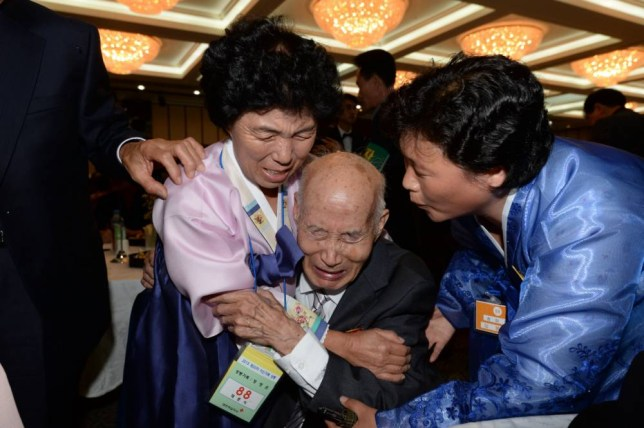North Korean Chae Hun Sik, 88, center, meets with his South Korean family members during the Separated Family Reunion Meeting at Diamond Mountain resort in North Korea, Tuesday, Oct. 20, 2015. Hundreds of elderly Koreans from divided North and South began three days of reunions Tuesday with loved ones many have had no contact with since the war between the countries more than 60 years ago. (Korea Pool via AP) KOREA OUT