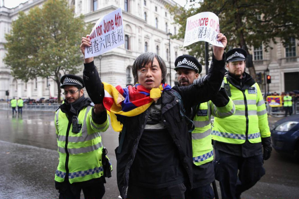 Survivor of Tiananmen Square massacre arrested in London during peaceful demonstration