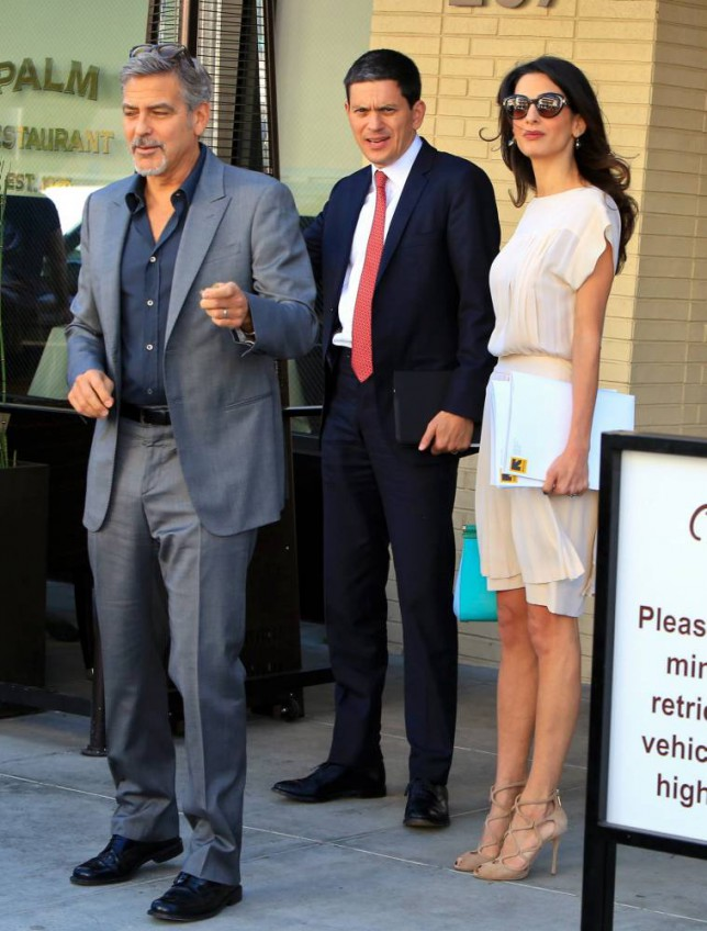 What's David Miliband doing with Amal and George Clooney?