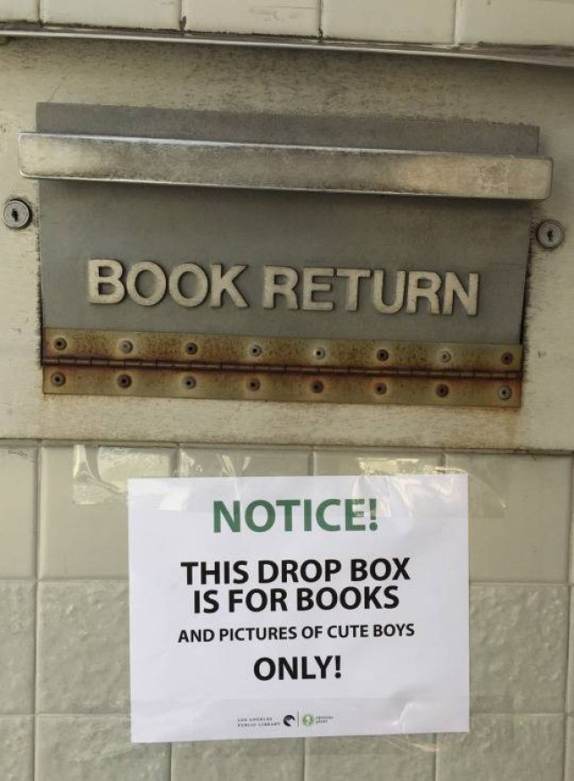 Pranksters are adding signs to library book drop offs Credit:obviousplant