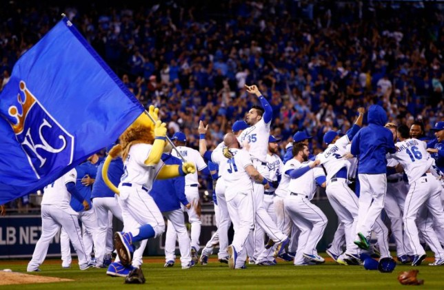 KANSAS CITY, MO - OCTOBER 23: The Kansas City Royals celebrate the 4-3 victory against the Toronto Blue Jays in game six of the 2015 MLB American League Championship Series at Kauffman Stadium on October 23, 2015 in Kansas City, Missouri. (Photo by Jamie Squire/Getty Images)