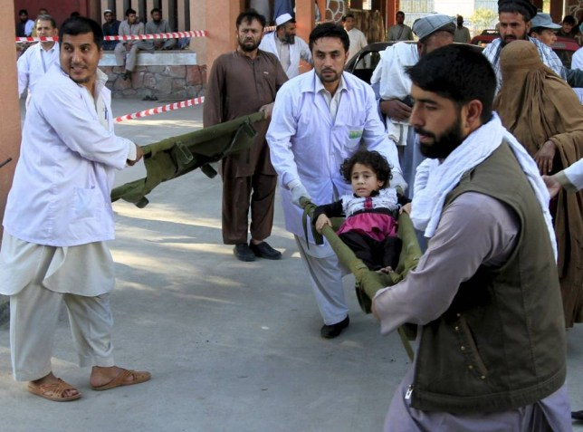 Rescue workers carry a girl who was injured after an earthquake, at a hospital in Jalalabad, Afghanistan, October 26, 2015. A powerful earthquake struck a remote area of northeastern Afghanistan on Monday, shaking the capital Kabul, as shockwaves were felt in northern India and in Pakistan's capital, where hundreds of people ran out of buildings as the ground rolled beneath them. REUTERS/ Parwiz