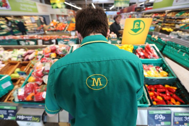 An employee works on the fresh vegetable display at a Morrisons supermarket, operated by William Morrisons Supermarkets Plc, in Crawley, U.K., on Tuesday, March 3, 2015. Wm Morrison Supermarkets Plc named David Potts as chief executive officer, tasking the former head of Tesco Plc's Asia unit with reviving the ailing British grocer. Photographer: Chris Ratcliffe/Bloomberg via Getty Images