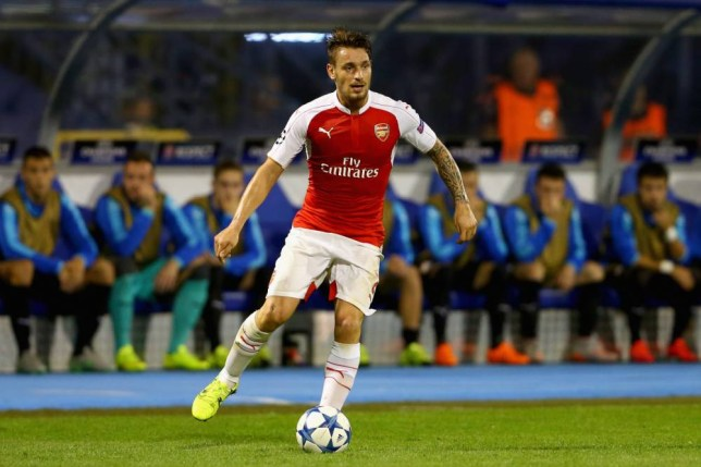ZAGREB, CROATIA - SEPTEMBER 16: Mathieu Debuchy of Londons runs with the ball during the UEFA Champions League Group F match between Dinamo Zagreb and Arsenal at Maksimir Stadium on September 16, 2015 in Zagreb, Croatia. (Photo by Alexander Hassenstein/Getty Images)