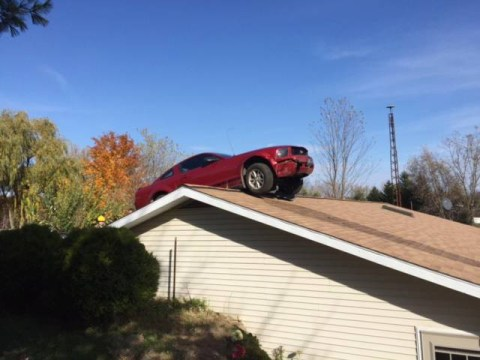 Old woman hears a bang, finds a car on the roof of her house