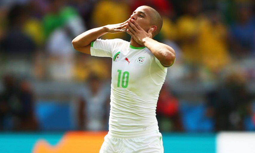Sofiane Feghouli of Algeria celebrates scoring his team's first goal on a penalty kick during the 2014 FIFA World Cup Group H match between Belgium and Algeria at Estadio Mineirao on June 17, 2014 in Belo Horizonte, Brazil. BELO HORIZONTE, BRAZIL - JUNE 17: (Photo by Ian Walton/Getty Images)