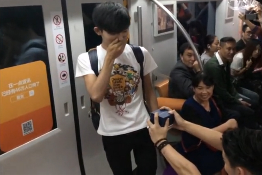 The beautiful moment a gay couple gets engaged on the Beijing subway
