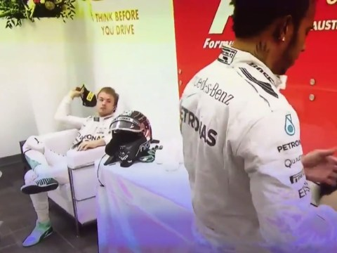 Nico Rosberg throws cap at teammate Lewis Hamilton after the Brit wins F1 Drivers' Championship
