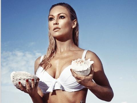 Strictly's Kristina Rihanoff recreates Ursula Andress' famous Bond girl white bikini pose