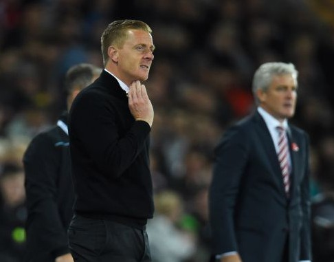 SWANSEA, WALES - OCTOBER 19: Garry Monk manager of Swansea City and Mark Hughes manager of Stoke City look on from ther touchline during the Barclays Premier League match between Swansea City and Stoke City at Liberty Stadium on October 19, 2015 in Swansea, Wales. (Photo by Stu Forster/Getty Images)
