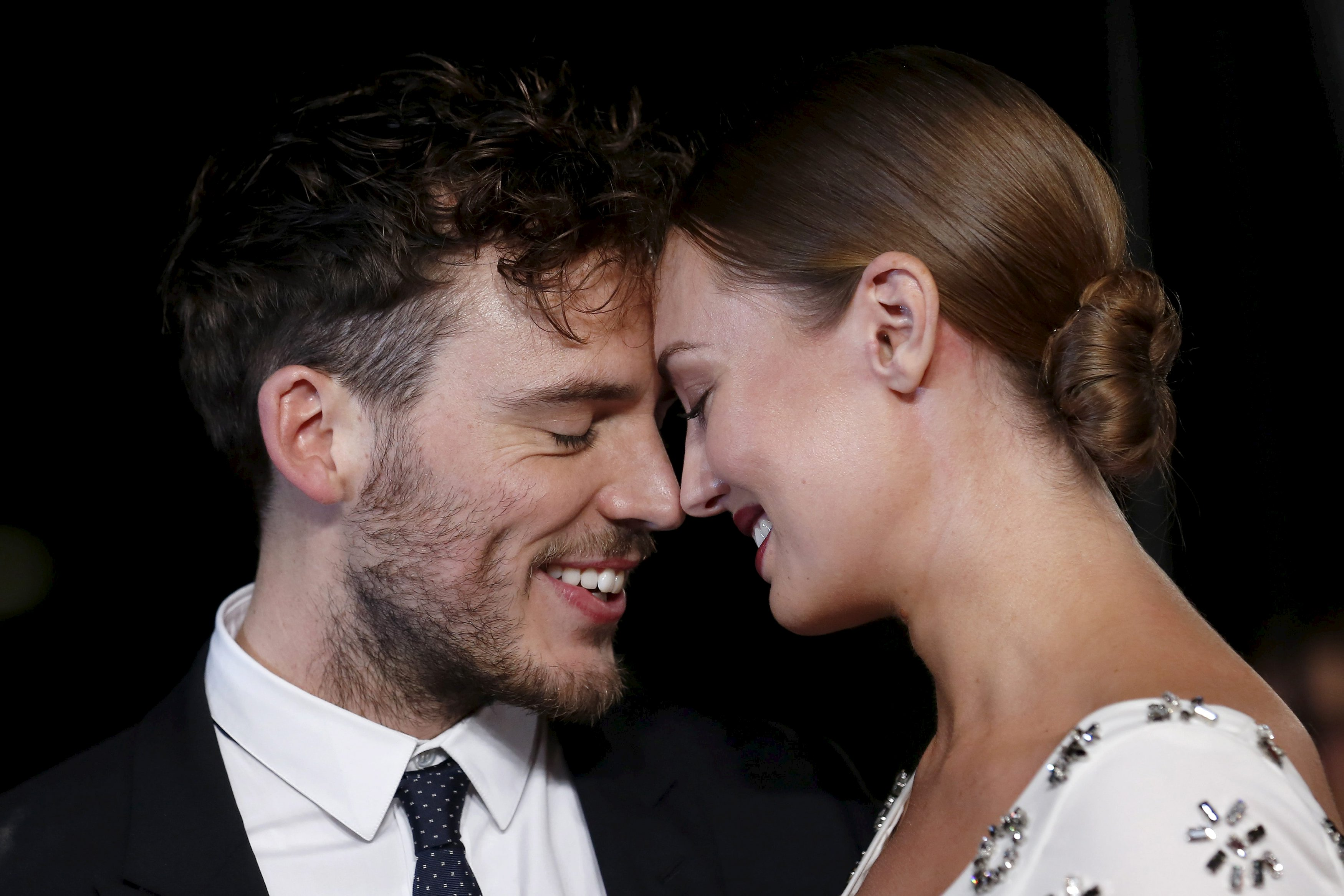 The Hunger Games: Mockingjay – Part 2 star Sam Claflin goes gooey over his pregnant wife at film premiere