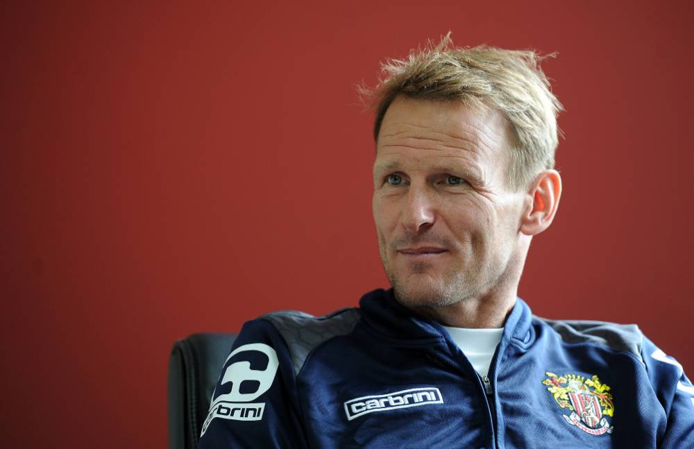 Stevenage manager Teddy Sheringham is officially out of retirement at the age of 49