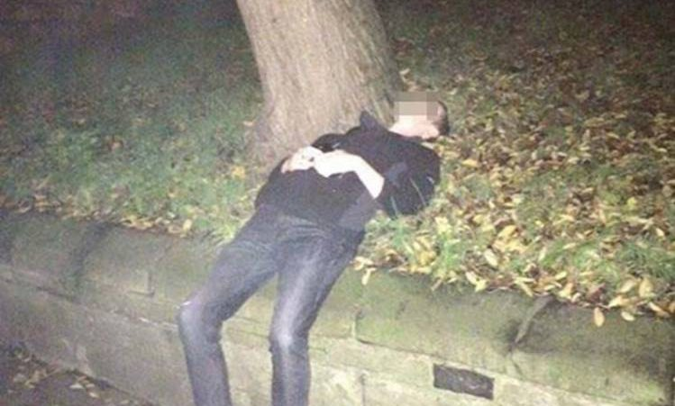 PIC FROM MERCURY PRESS (PICTURED: Lewis Sharp's photo of a young man he found on a grass verge in York. The man mistook the area for his bedroom asking Lewis to 'shut the window') A lad got so drunk that he mistook a small hill alongside a busy street for his bedroom and went to sleep ñ and asked a passerby to ëshut the windowí as he was COLD. Lewis Sharp, 24, was returning home after seeing some friends in York city centre last night (TUES) when he spotted the man, who he believes was a student, lay on the grassy verge. As he went over to check on the man, he was briefly roused from his slumber and asked Lewis to ëshut my window for me, itís freezing in hereí. SEE MERCURY COPY
