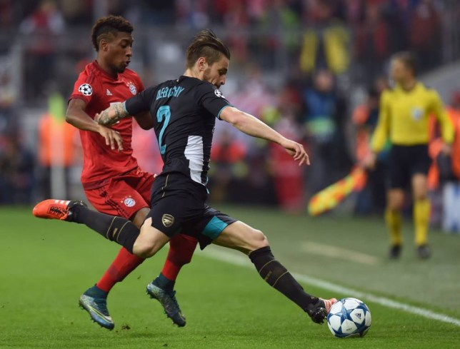 Bayern Munich's French midfielder Kingsley Coman (L) and Arsenal's French defender Mathieu Debuchy vie for the ball during the UEFA Champions League Group F second-leg football match between FC Bayern Munich and Arsenal FC in Munich, southern Germany, on November 4, 2015. AFP PHOTO / CHRISTOF STACHECHRISTOF STACHE/AFP/Getty Images