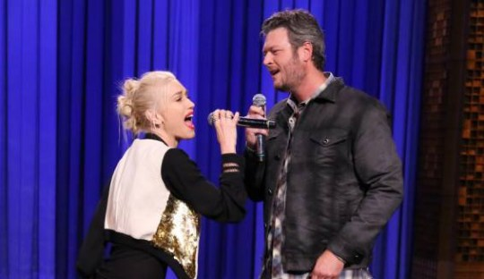 Singer Gwen Stefani and singer Blake Shelton during a lip synch battle on September 17, 2014 -- (Photo by: Douglas Gorenstein/NBC/NBCU Photo Bank)