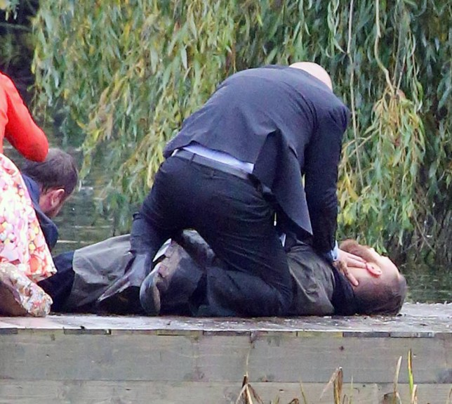 EXCLUSIVE ALL ROUND HUGE XMAS EASTENDERS SPOILER. Very last scenes of Dean (Matt D'Angelo) as he drowns in a lake on the day of Mick Carter and Linda's wedding. Mick is seen dragging Deans body out of the water with Phil and Mick trying to resuscitate him with Shirley,Tina and Linda watching and Linda in her muddy wedding dress . EMBARGOED UNTIL 23.55pm 8/11/2015 NO ONLINE USAGE UNTIL FEE AGREED WITH THIS OFFICE AND NOT TO BE USED UNTIL 23.55pm 08/11/2015 BYLINE : ISOIMAGES must be used