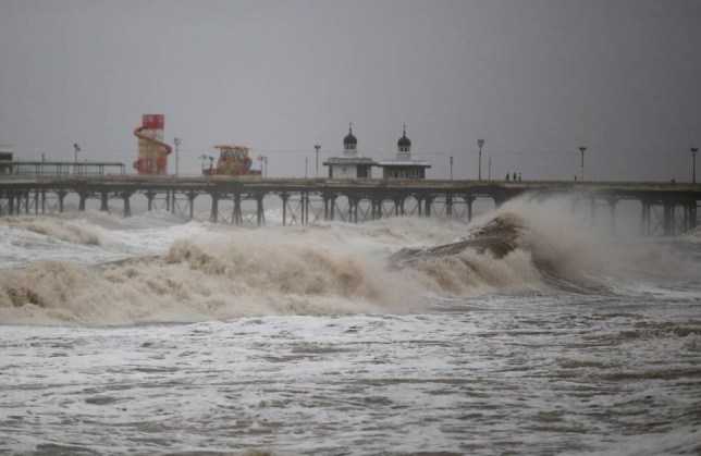 BLACKPOOL, ENGLAND - NOVEMBER 09: Waves whipped up by high winds hit Blackpool's North Pier as Britain's first ever named storm, Storm Abigail, hits the North West on November 9, 2015 in Blackpool, England. The new naming system was introduced in September by the Met Office. To qualify for a name, the stormy weather must have the potential to cause medium or high wind impacts. (Photo by Christopher Furlong/Getty Images)