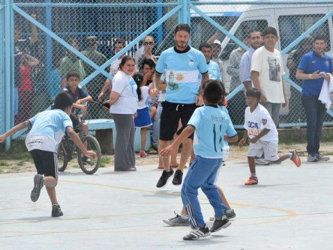 David Beckham plays football match with kids in Argentinian shanty town