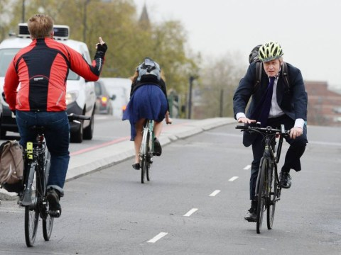 A cyclist gave Boris Johnson the finger as he cycled past on Vauxhall Bridge