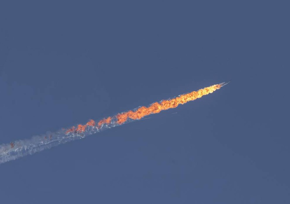 HATAY, TURKEY - NOVEMBER 24: Unidentified aircraft goes down in Kizildag region of Turkey's Hatay province, close to the Syrian border, on November 24, 2015. It remains unclear to which country the aircraft, which went down in Syria's northwestern Turkmen town of Bayirbucak, belongs to. (Photo by Fatih Akta/Anadolu Agency/Getty Images)