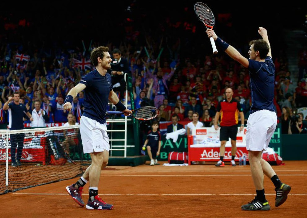 GHENT, BELGIUM - NOVEMBER 28: Jamie Murray and Andy Murray of Great Britain celebrate defeating Steve Darcis and David Goffin of Belgium in the doubles during day two of the Davis Cup Final between Belgium and Great Britain at Flanders Expo on November 28, 2015 in Ghent, Belgium. (Photo by Julian Finney/Getty Images)