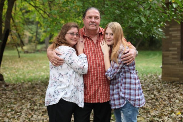 *** EXCLUSIVE - VIDEO AVAILABLE *** MANSFIELD, OH - OCTOBER 09: Thom Miller with his wives Belinda Miller and Reba Kerfoot at their home on October 9, 2015 in Mansfield, Ohio. A 60-year-old pastor has married his pregnant 19-year-old girlfriend with the full support of his 44-year-old wife. Thom Miller is in the process of building a huge house for his two wives with each of them occupying their own wing that he will visit on a regular schedule. He currently lives in a smaller home and has each of his wives spend three nights with him before the other one takes her turn. Thom, who is a former mafia enforcer turned pastor, had talked about polygamy with his first wife Belinda but it was seven years before they settled on 19-year-old Reba Kerfootruba joining their family. The trio plans to raise Reba and Thomís future biological child together as a family.  PHOTOGRAPH BY Ruaridh Connellan / Barcroft USA UK Office, London. T +44 845 370 2233 W www.barcroftmedia.com USA Office, New York City. T +1 212 796 2458 W www.barcroftusa.com Indian Office, Delhi. T +91 11 4053 2429 W www.barcroftindia.com