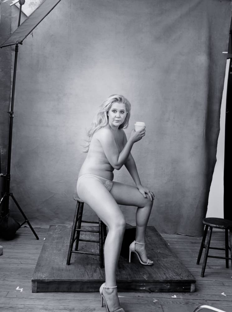 Amy Schumer poses nude with a cup of coffee as one of Pirelli's 'women of achievement'