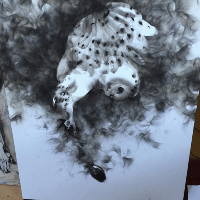 artist creates paintings using fire and soot owl