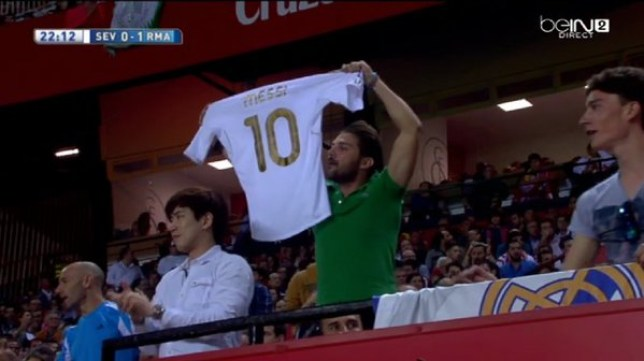 4cb958c5565 Barcelona news  Real Madrid fan holds up  Messi 10  shirt at Sevilla ...