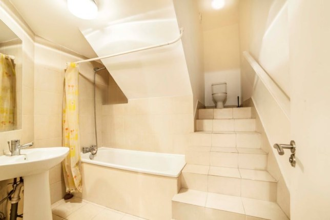 Apparently it's a thing to have a toilet at the top of a staircase (Picture: auctionhouselondon.co.uk)