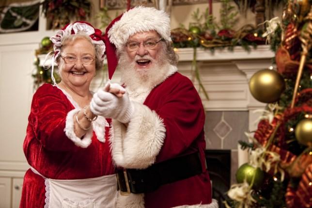 Santa dances with Mrs. Claus