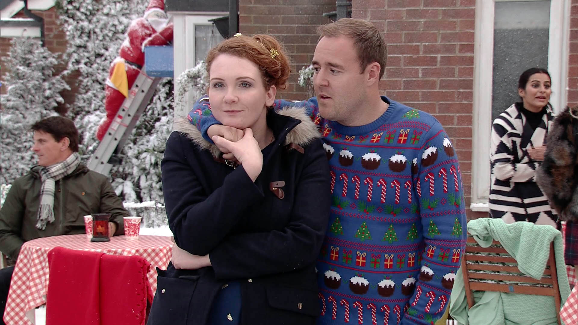 FROM ITV STRICT EMBARGO - Tuesday 15 December 2015 Coronation Street - Ep 8802 Christmas Day 2015 Tyrone Dobbs [ALAN HALSALL] and Fiz Stape [JENNIE MCALPINE] and lead the girls out on to the street to reveal Lapland, Santa pulls up. Getting down on one knee in the snow, Tyrone produces the ring and proposes to Fiz. Will Fiz accept? Picture desk contact - david.crook@itv.com This photograph is (C) ITV Plc and can only be reproduced for editorial purposes directly in connection with the programme or event mentioned above, or ITV plc. Once made available by ITV plc Picture Desk, this photograph can be reproduced once only up until the transmission [TX] date and no reproduction fee will be charged. Any subsequent usage may incur a fee. This photograph must not be manipulated [excluding basic cropping] in a manner which alters the visual appearance of the person photographed deemed detrimental or inappropriate by ITV plc Picture Desk. This photograph must not be syndicated to any other company, publication or website, or permanently archived, without the express written permission of ITV Plc Picture Desk. Full Terms and conditions are available on the website www.itvpictures.com