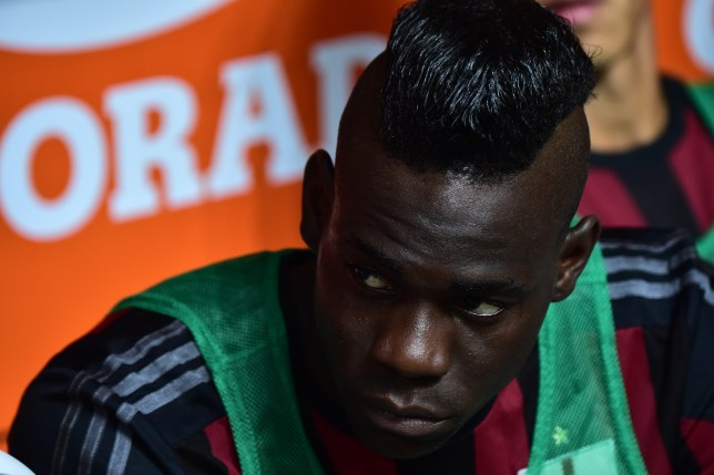 AC Milan's forward from Italy Mario Balotelli looks on before the Italian Serie A football match between AC Milan and Empoli at San Siro Stadium in Milan on August 29, 2015. AFP PHOTO / GIUSEPPE CACACE (Photo credit should read GIUSEPPE CACACE/AFP/Getty Images)