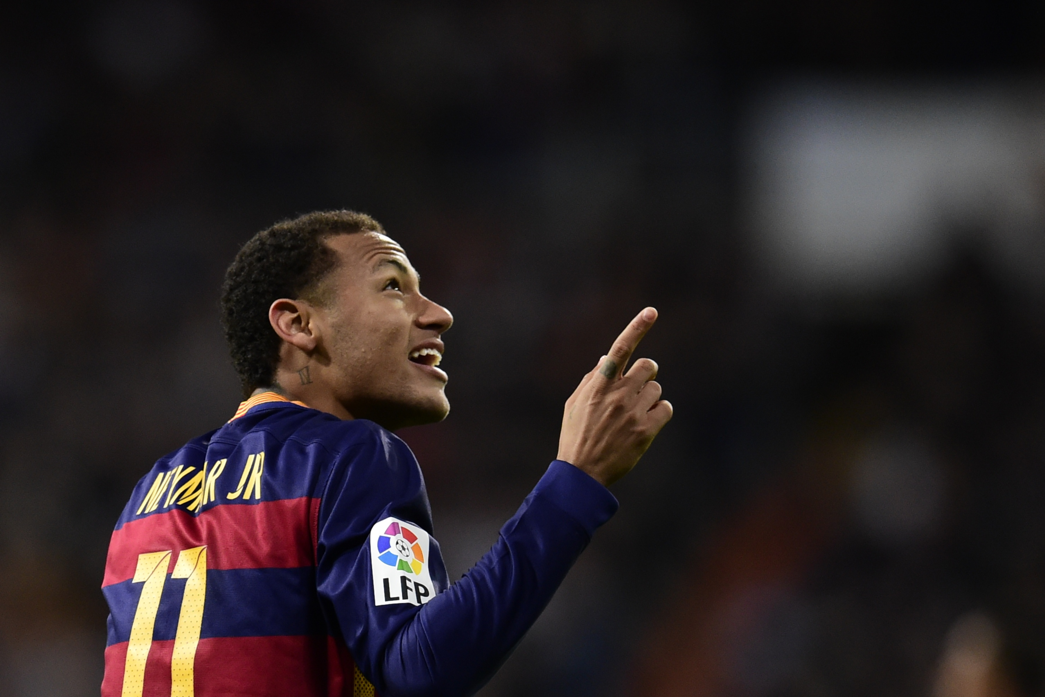 """Barcelona's Brazilian forward Neymar gestures during the Spanish league """"Clasico"""" football match Real Madrid CF vs FC Barcelona at the Santiago Bernabeu stadium in Madrid on November 21, 2015. / AFP / JAVIER SORIANO (Photo credit should read JAVIER SORIANO/AFP/Getty Images)"""