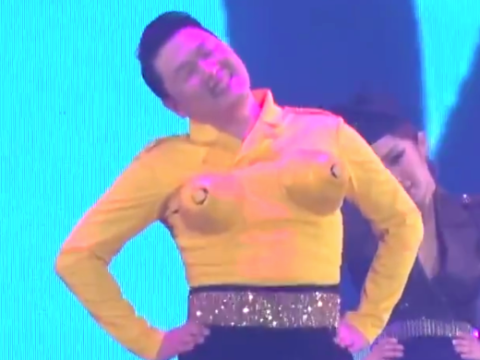 Yep, that's the guy from Gangnam Style now twerking around with big lemon-like boobs