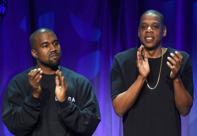 Rappers Kanye West (L) and Jay-Z onstage at the Tidal launch event #TIDALforALL at Skylight at Moynihan Station on March 30, 2015 in New York City. NEW YORK, NY - MARCH 30: (Photo by Jamie McCarthy/Getty Images for Roc Nation)