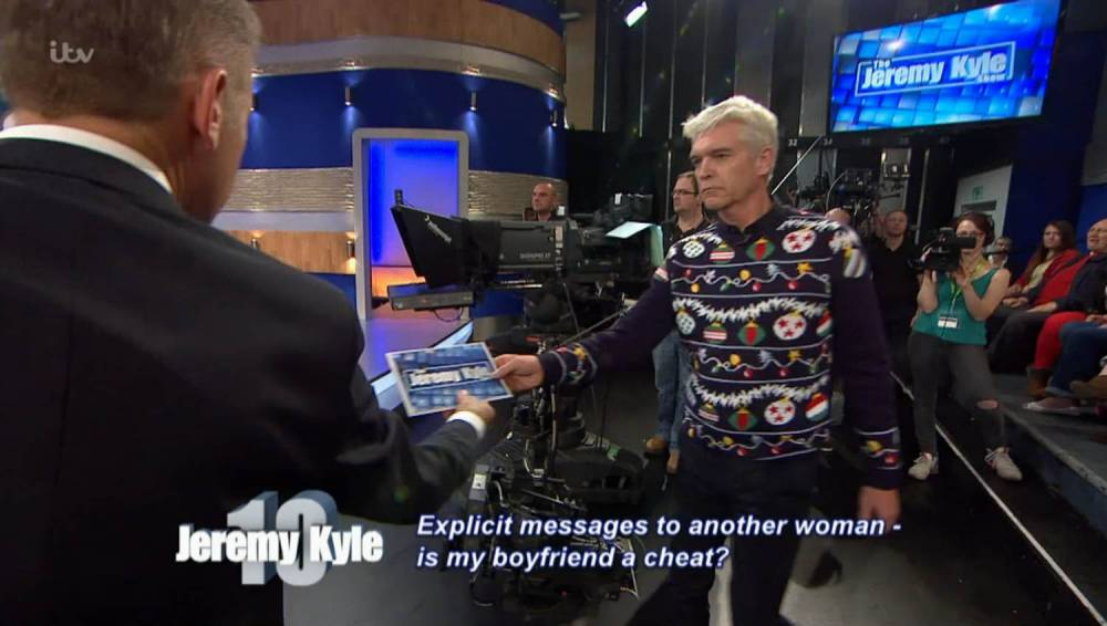 ****Ruckas Videograbs**** (01322) 861777 *IMPORTANT* Please credit ITV for this picture. 01/12/15 SEEN HERE: Schofield hands over some lie detector results on The Jeremy Kyle Show... Grabs of Phillip Schofield appearing on all ITV shows between 6am and 10pm for his #PipKnit challange for Text Santa. Office (UK) : 01322 861777 Mobile (UK) : 07742 164 106 **IMPORTANT - PLEASE READ** The video grabs supplied by Ruckas Pictures always remain the copyright of the programme makers, we provide a service to purely capture and supply the images to the client, securing the copyright of the images will always remain the responsibility of the publisher at all times. Standard terms, conditions & minimum fees apply to our videograbs unless varied by agreement prior to publication.