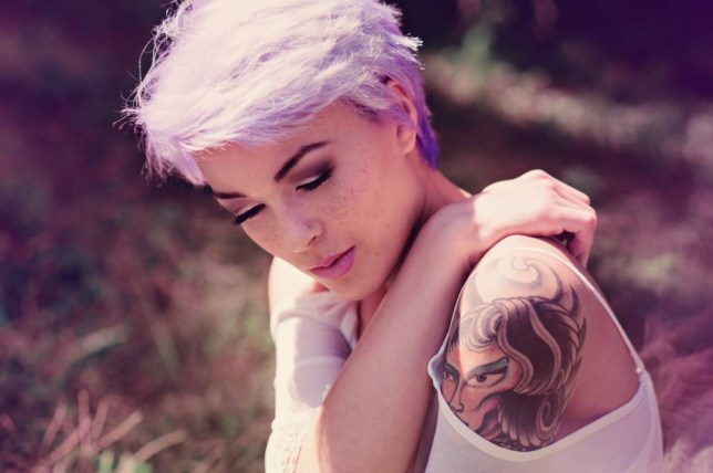 Portrait of girl with lavender hair and tattoos