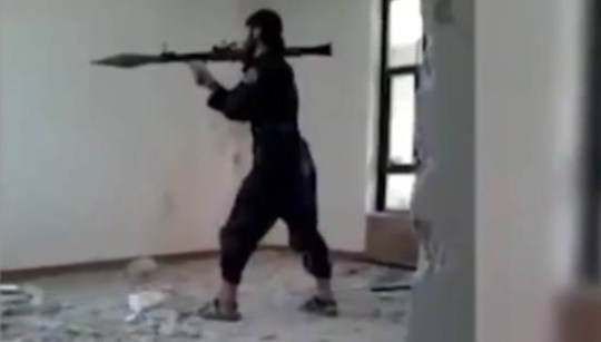 Video footage captures the moment an ISIS fighter's rocket launcher blows up as he tries to fire it.