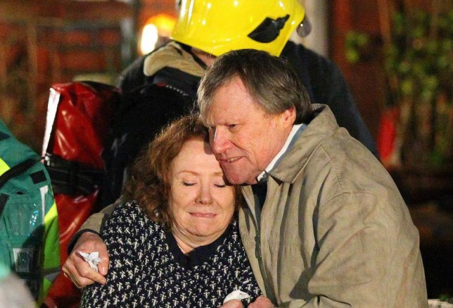 Coronation Streets Roy Cropper (played by David Neilson) arrives at Cathy Matthew's (played by Melanie Hill) house with her sister Nessa Warner (played by Sadie Shimmin) to find the house on fire. Roy eventually finds a front door keys and lets himself in. Seconds later Roy manages to drag Cathy out of the house and the fire brigade and ambulance turn up and they end up in the back of the ambulance where Cathy explains she had fallen asleep on the sofa and left something cooking which has caused the fire........3.12.15.