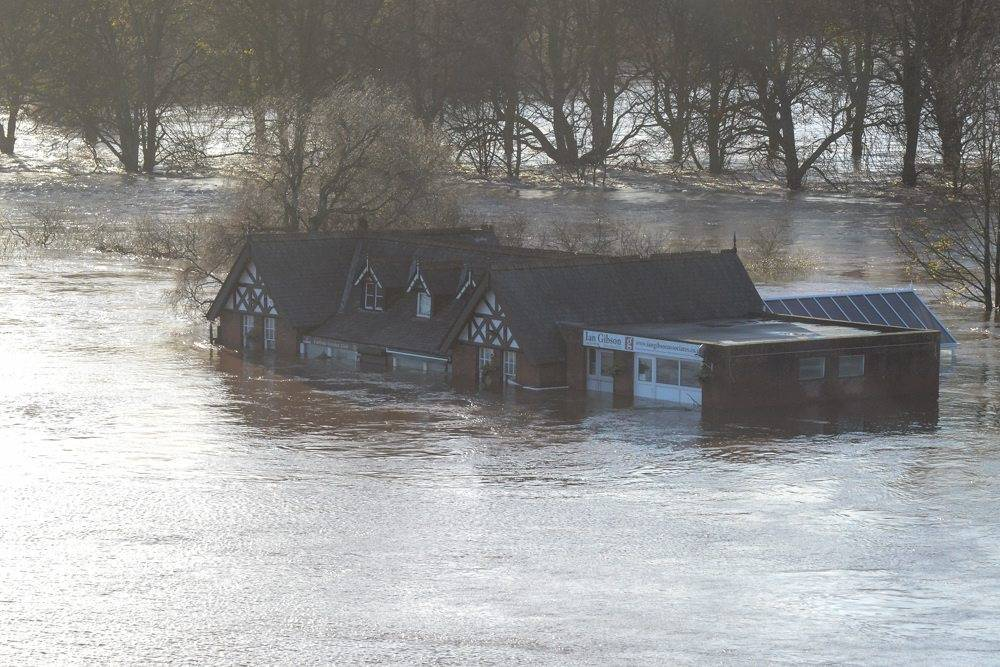 epa05057687 A handout picture made available by the British Ministry of Defence (MOD) shows partially submerged buildings, North West England, Britain, 06 December 2015. Army personnel from 2nd Battalion Duke of Lancaster's Regiment, based in Weeton Barracks near Preston, have been deployed to assist with the flooding response operation with around 350 personnel potentially available within the Battalion. Storm Desmond brought extreme weather to many other areas of northern England and Scotland as the government issued severe flood warnings for 31 areas of England and Wales, with many of the warnings along swollen rivers. EPA/BRITISH MINISTRY OF DEFENCE/CPL MICHAEL STRACHAN MANDATORY CREDIT: CROWN COPYRIGHT HANDOUT EDITORIAL USE ONLY/NO SALES