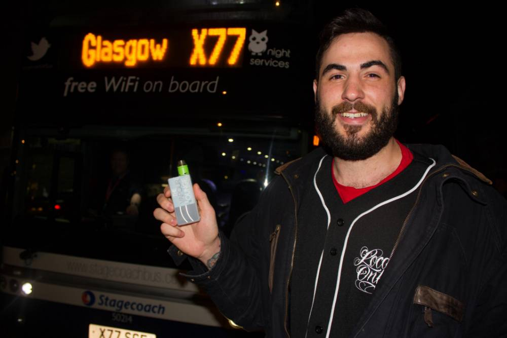 PIC BY DANNY BRAY/MERCURY PRESS (PICTURED: CHRIS BARRON, 25, WITH THE X77 BUS HE WAS HAULED OFF UNDER A CLOOUD OF SUSPICION) A smoker claims his BEARD led to him being considered a terrorist when he cleaned his e-cigarette on a bus ñ sparking a bomb scare. Chris Barron, 25, was coming home from staying with a friend in Glasgow to his home in Ayr when a fellow passenger mistook his e-cig vapouriser for an explosive device. The bus was immediately stopped on the M77 as police closed the motorway and swooped on the vehicle to search it ñ but eventually realised it was a false alarm. Dual nationality Chris, who grew up in the US but has been in Scotland since 2001, believes the passenger thought he was a terrorist because he had dark hair and a beard. SEE MERCURY COPY