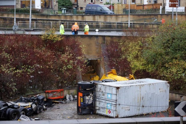 The scene of a fatal accident in Bradford where a lorry crashed into a subway underpass in the early hours of this morning. See Ross Parry copy RPYLORRY : POLICE have confirmed an HGV driver was killed early today when his vehicle plunged off a roundabout in Wakefield Road, Bradford, on to the subway below. A West Yorkshire Police spokesman said the driver of the wagon was found to be dead at the scene after his vehicle went through the railings and fell into the pedestrian subway below in the middle of the roundabout.