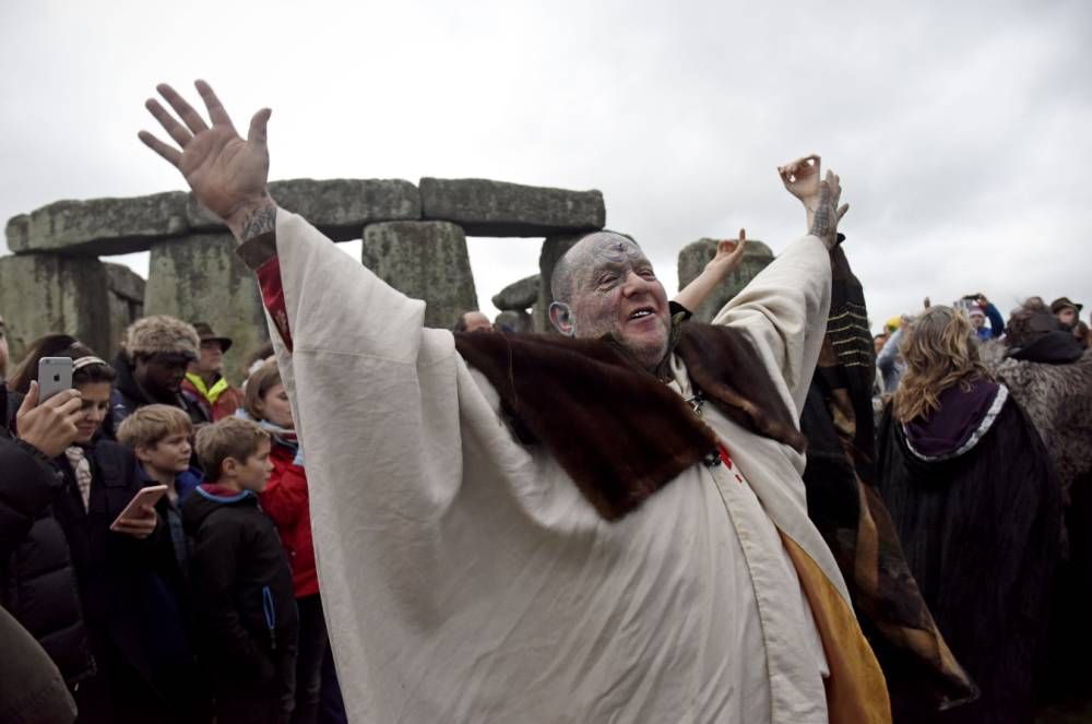 Pictured: People enjoy the winter solstice at Stonehenge in Wiltshire. Thousands of people including druids and pagans have attended the winter solstice at Stonehenge. The Winter solstice happens every year when the Sun reaches its most southerly declination of -23.5 degrees, and marking the shortest day of the year. © Tom Harrison/ Solent News & Photo Agency UK +44 (0) 2380 458800