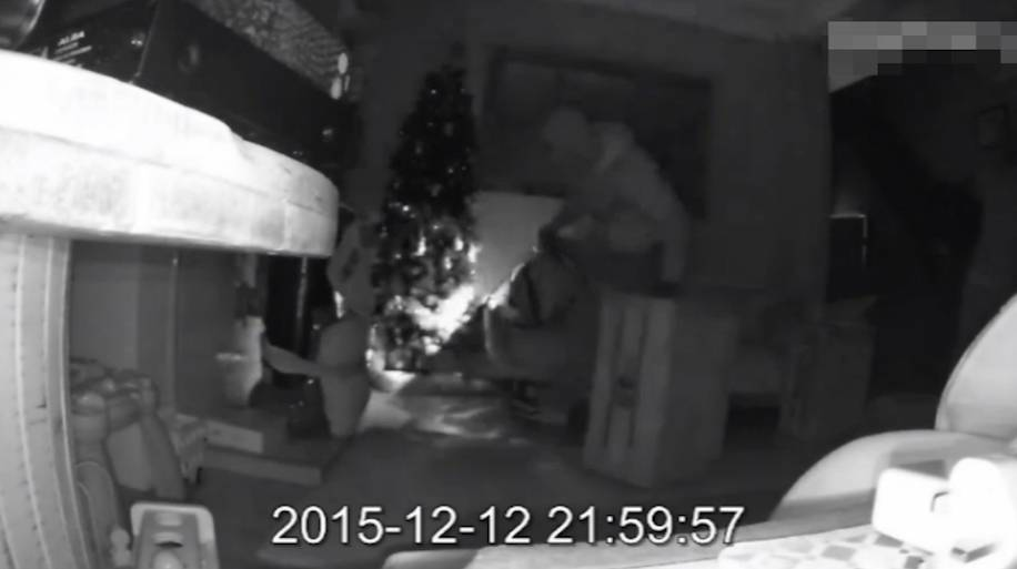CCTV catches thieves ransacking home and stealing presents just days before Christmas.